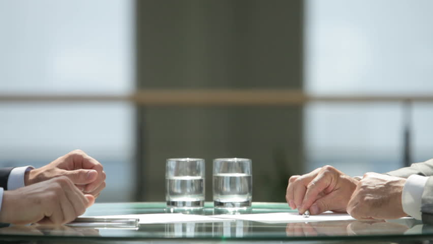 Business people signing the contracts together concluding the deal by a firm handshake Royalty-Free Stock Footage #2591144