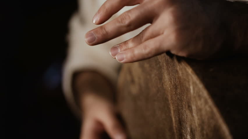 Extremelly close up shot of man's hands drumming out a beat on an arabic percussion drum named Bendir at home. Shot on black background | Shutterstock HD Video #25921889