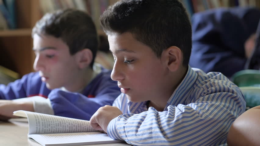 BEIRUT, LEBANON - 2016: Students in 6th grade read books at the school's library. Education in Lebanon is compulsory from age 6 to age 14 | Shutterstock HD Video #25946459