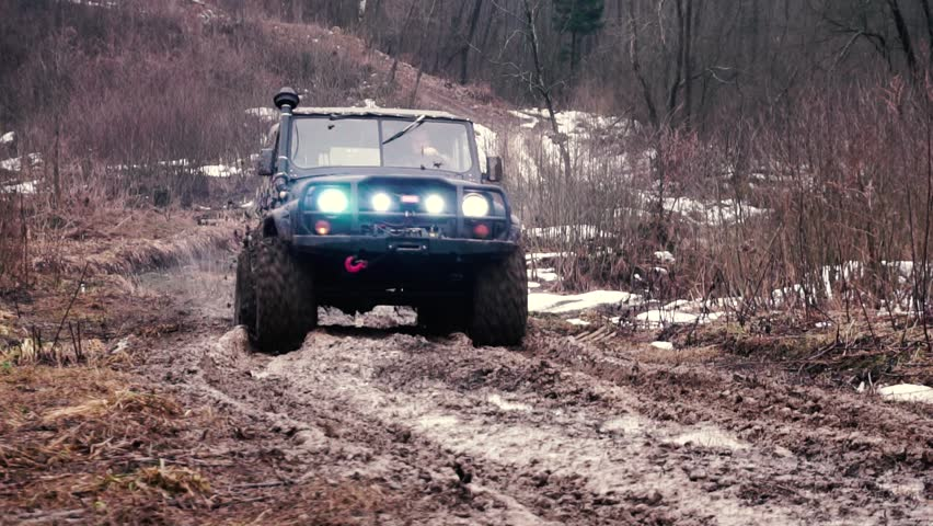 SUV in the mud. Slow motion