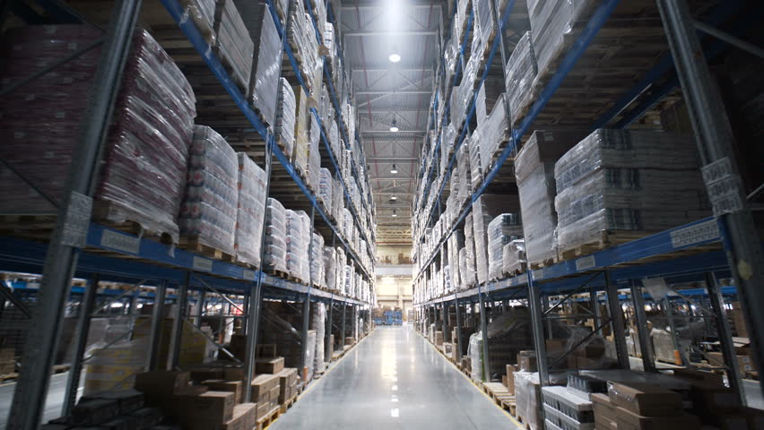 Warehouses large logistics commerce structure with boxes on the shelf. Teamwork male person industry production, using machine work and vehicle, delivering merchandise for transnational export indoors #25957949