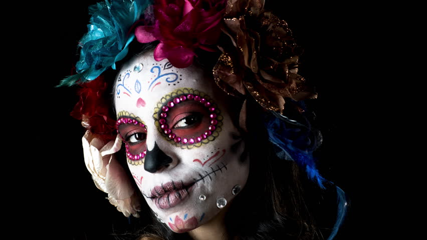 Beautiful woman with custom designed candy skull mexican day of the dead face make up. this version has been run through effects to give it intentional video static and distortion
