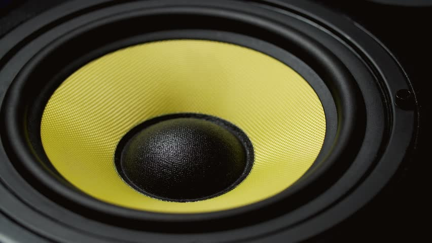 Close up at moving sub-woofer. Speaker part. Black and yellow colors of membrane. Concept of musical instrument. 4k video shot. #25982960