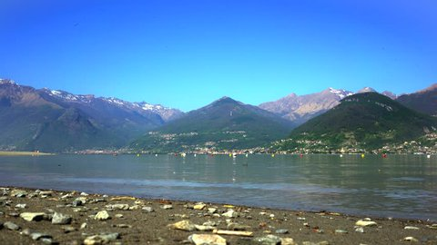 Colico beach on lake Como with alps view