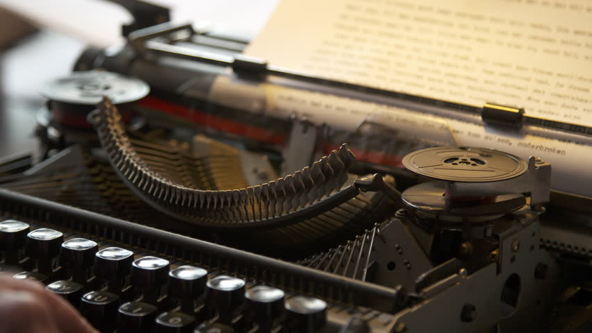 Typing on a piece of paper on a typewriter, close up. | Shutterstock HD Video #25993370