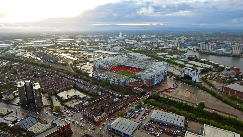Aerial View of Manchester Cityscape and Manchester United's Iconic Stadium Old Trafford Football Ground with Beautiful Sunset. Old Trafford is a football stadium and the home of Manchester United 4K