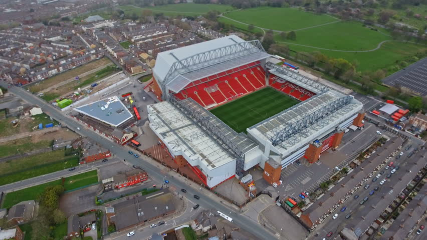 Helicopter Flight Aerial View of Anfield Stadium in Liverpool. Iconic football ground and home of one of England's most successful sides, Liverpool FC in 4K Ultra HD   Shutterstock HD Video #25996127