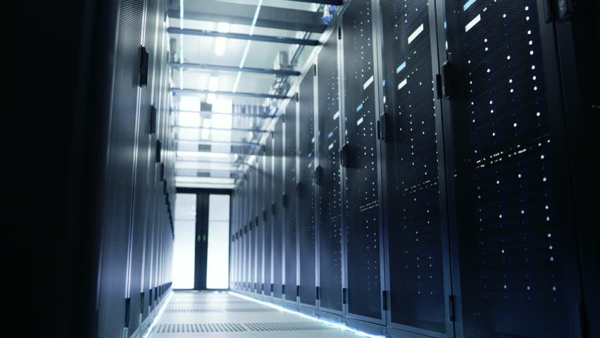 Camera Moves Through Big Working Data Center with Server Racks and Glass Ceiling. Shot on RED EPIC-W 8K Helium Cinema Camera.