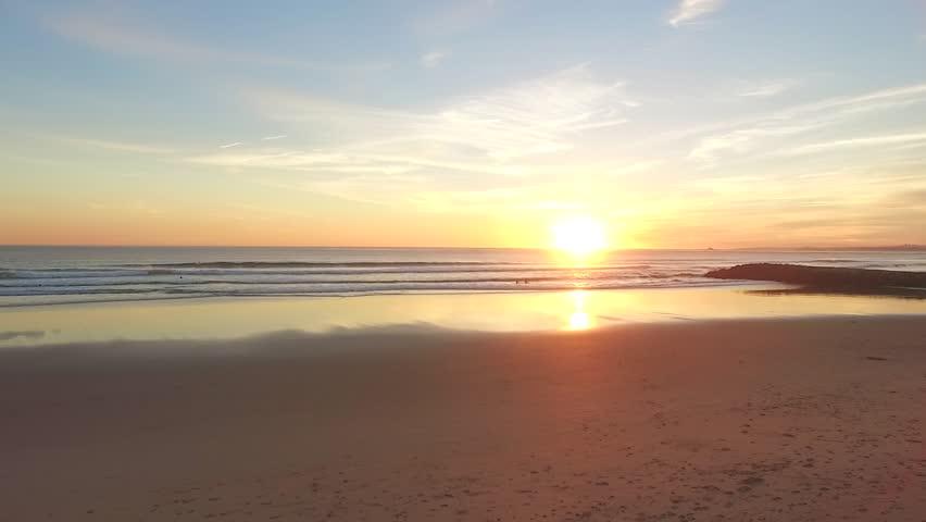 Aerial video in motion of sunset in the Atlantic Ocean in Costa da Caparica, Lisbon, Portugal #26011187