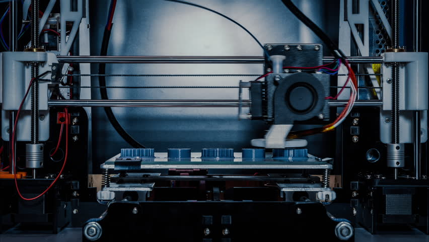 3D diy printer printing plastic mechanical parts in timelapse.An open source diy 3d printer is printing gears and pulleys,using disposable biodegreadable PLA material (filament)