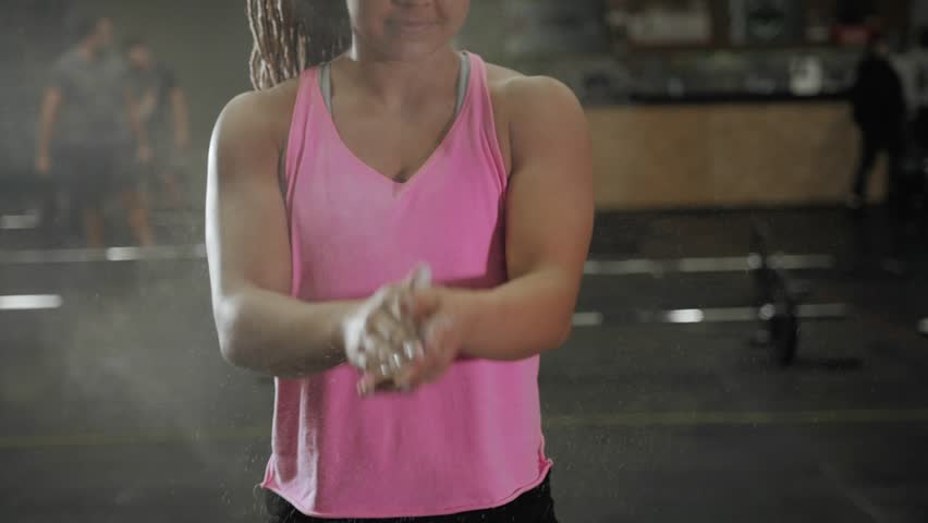 Gym Chalk Magnesium Carbonate hands clapping young american woman for climbing workout