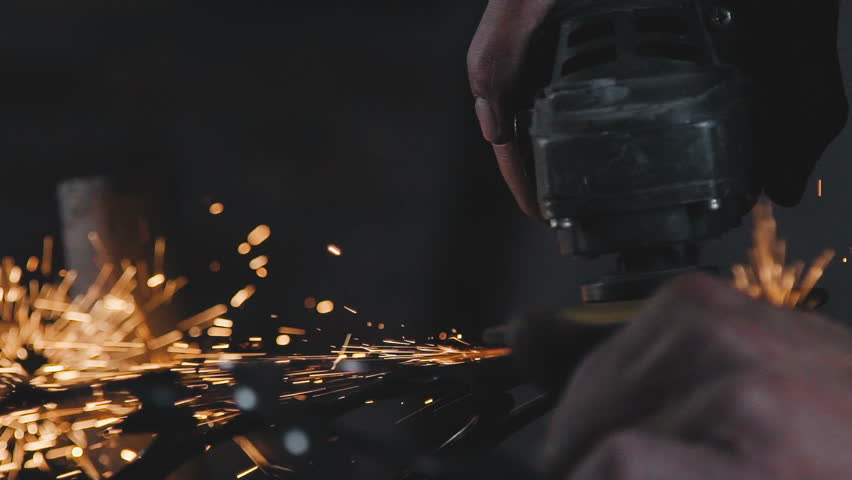 Decorative metalworking: the creation of an openwork decorative metal element. The power tool is in operation. The process of creating a decorative metal product: forged openwork metal.