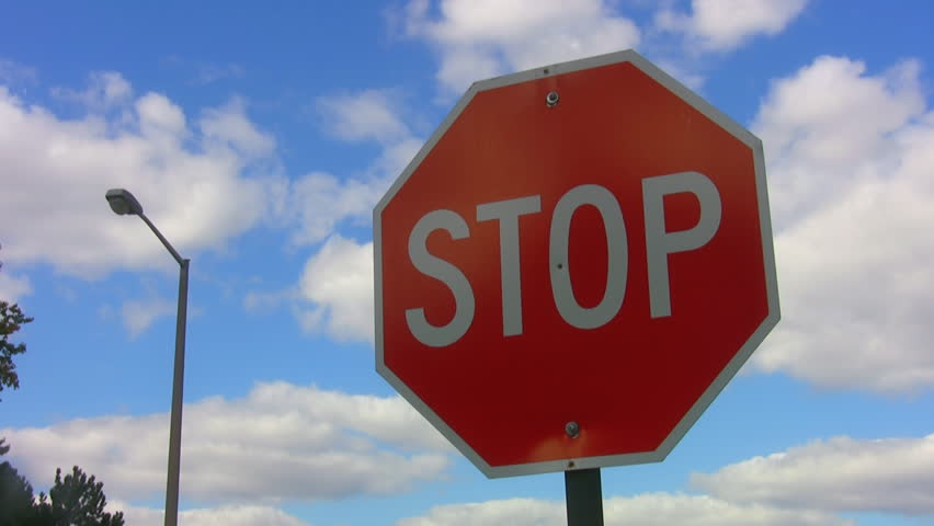 Stop! Stop sign with timelapse clouds. Colour-adjusted for impact. | Shutterstock HD Video #260773