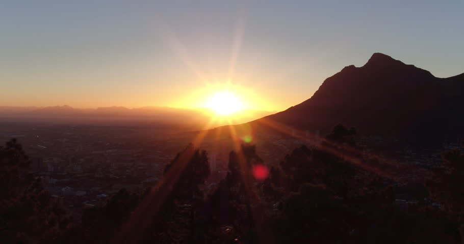 Drone reveal trough the trees on Signal hill into Cape Town city during sunrise. | Shutterstock HD Video #26081648