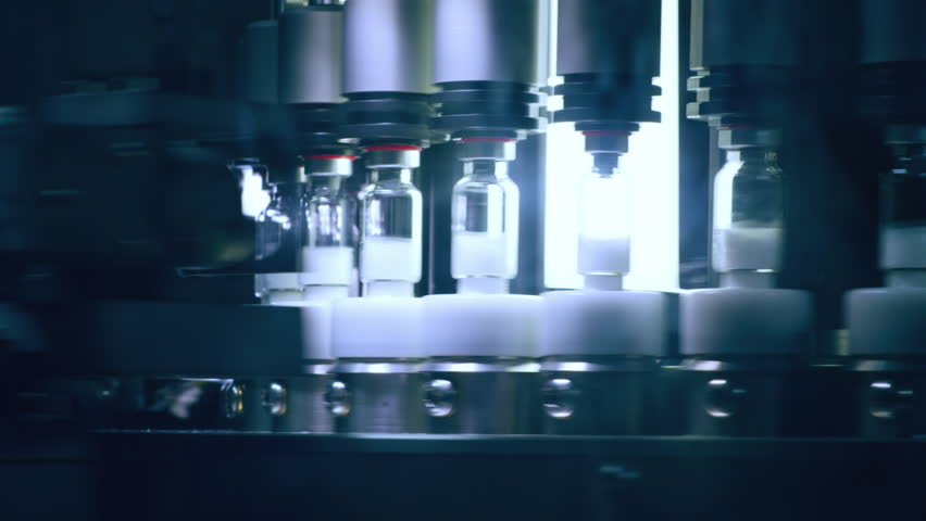Medical vials manufacturing line at pharmaceutical factory. Quality control of pharmaceutical vials. Drugs automated production line. Ampules on pharmaceutical manufacturing line at pharmacy factory | Shutterstock HD Video #26085557