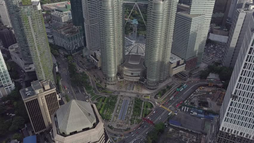 KUALA LUMPUR, MALAYSIA - February 26th 2017 The Petronas Twin Towers in the afternoon from the air , tilt up from the street to the towers. | Shutterstock HD Video #26088476
