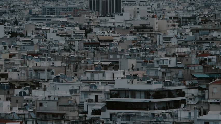 EDITORIAL:April 21 2017 Athens,Greece.Athenian rooftops at dawn aerial locked down view.Establishing shot of overly polulated area of Athens Greece at dawn.Residential buildings in view.   Shutterstock HD Video #26096243