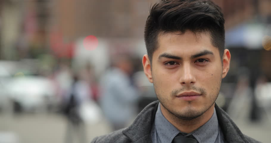 Young Hispanic Latino man in city face portrait | Shutterstock HD Video #26109116