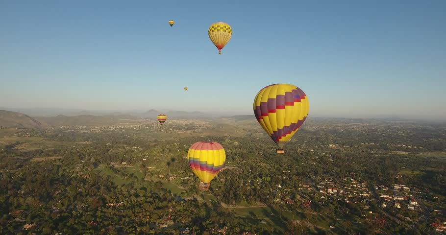 Hot Air Balloons floats across the sky and over residential area. San Diego, Rancho Santa Fe, Del Mar, Encinitas   Shutterstock HD Video #26109611