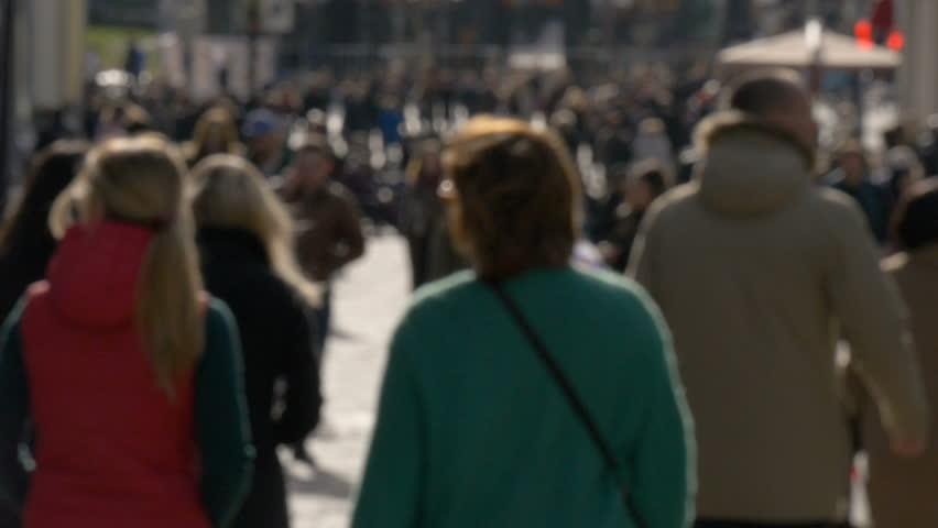 Blurred unrecognizable people walk along sunny spring street slow motion video #26142752