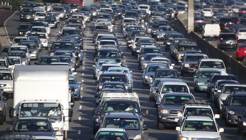 LOS ANGELES, CALIFORNIA, USA - AUGUST 15, 2015: Traffic jam on California freeway in Los Angeles during the 100 degrees Fahrenheit  heat wave visual distortion