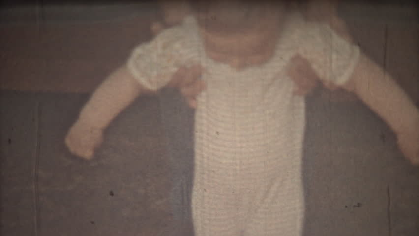 Family chronicle: Father teach their child to walk. 8mm retro camera.