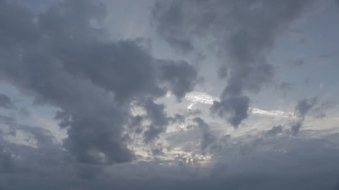 A time-lapse of clouds moving through a bright blue sky.