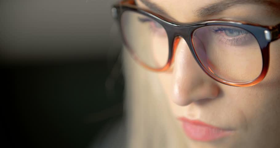 Businesswoman Wearing Eyeglasses While Using Laptop In Office | Shutterstock HD Video #26179355