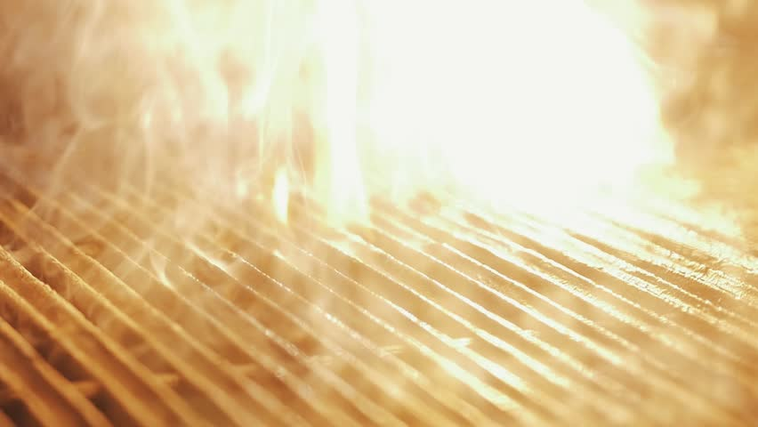 Black cooking brush apply oil on hot smoking grill, producing hight strong fire flames, close up slow motion | Shutterstock HD Video #26179907