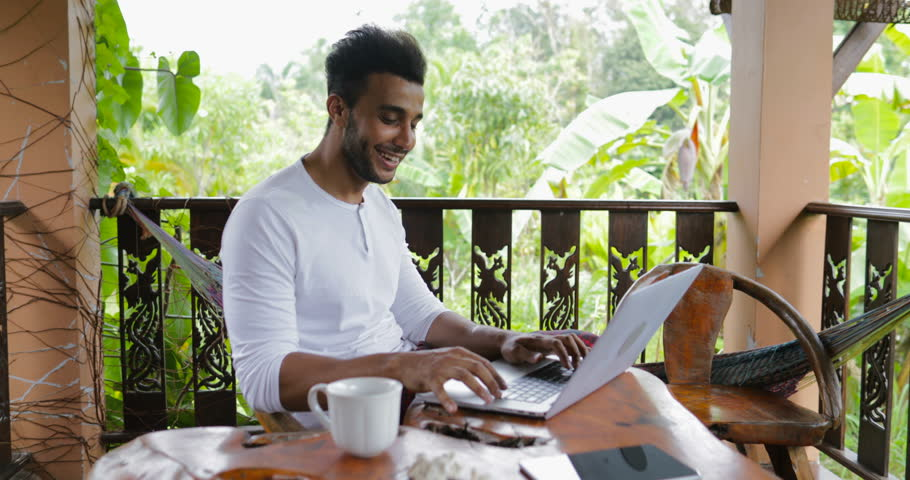 Young Man Working With Laptop Computer On Terrace Drink Coffee, Hispanic Guy Typing Chatting Online Slow Motion 60 | Shutterstock HD Video #26198036