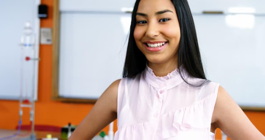 Portrait of smiling mixed race schoolgirl in classroom at school   Shutterstock HD Video #26205173