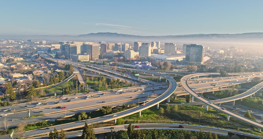 Aerial View Of San Jose City And Congested Freeway Traffic At Rush Hour
