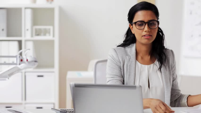 business, people, paperwork and technology concept - businesswoman with laptop computer and papers at office Royalty-Free Stock Footage #26238791