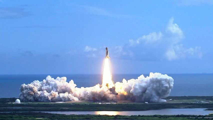 Space shuttle lifting off over the water. Rocket launch.