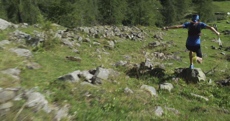 Caucasian trail runner running in mountain through woods, villages. 4k gimbal wide back video shot | Shutterstock HD Video #26261000