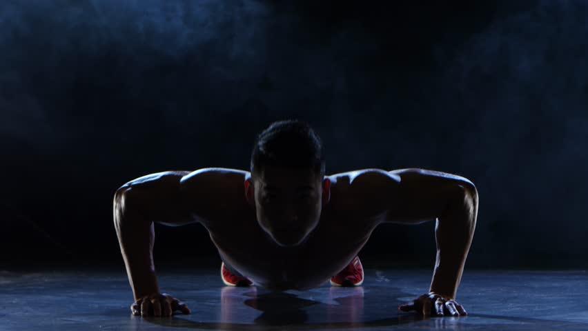 Asian muscular man push ups. Black smoke background. Silhouette   Shutterstock HD Video #26265677