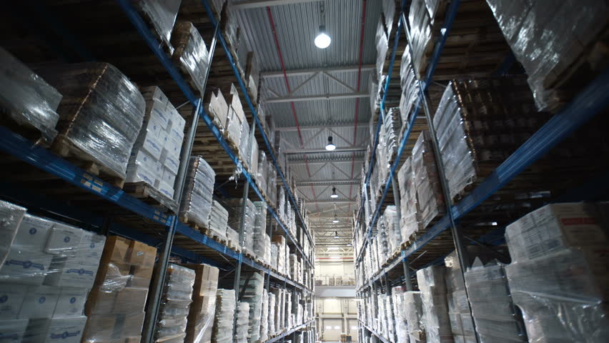 Big factory warehouse. store Aisles. Camera travels inside a large store. Warehouse shipping. Logistics business and shipping facility with forklift to move boxes and goods | Shutterstock HD Video #26284265