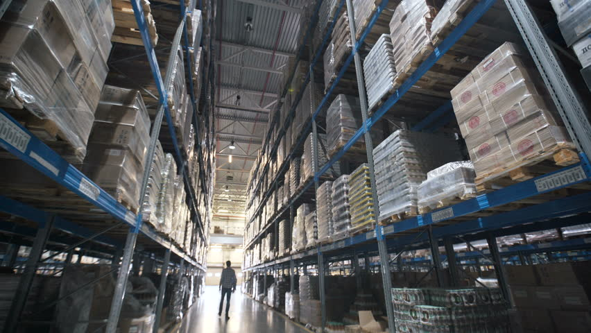 Moving between palettes with ordered goods and materials at warehouse. Large warehouse logistics terminal. Shot inside Logistic Store | Shutterstock HD Video #26284277