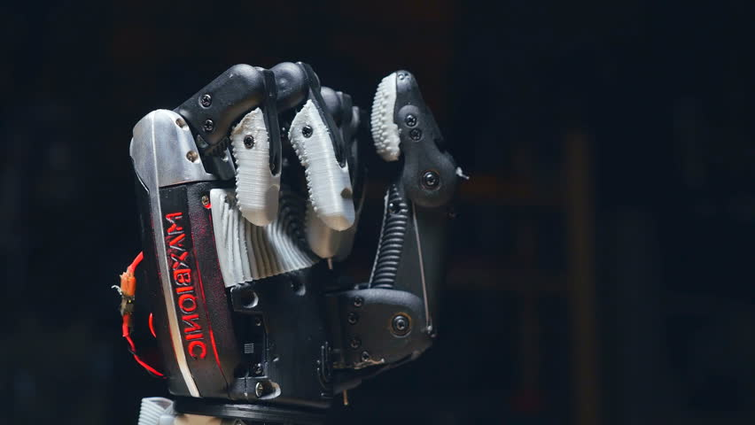 The robot hand is opening in the slow motion. #26296862