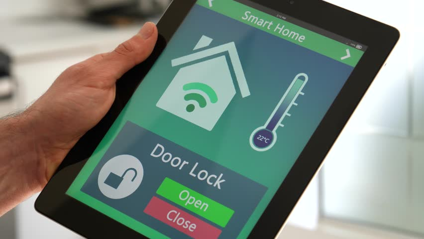 Controlling the door lock of a home with a tablet app for smart home. | Shutterstock HD Video #26314508