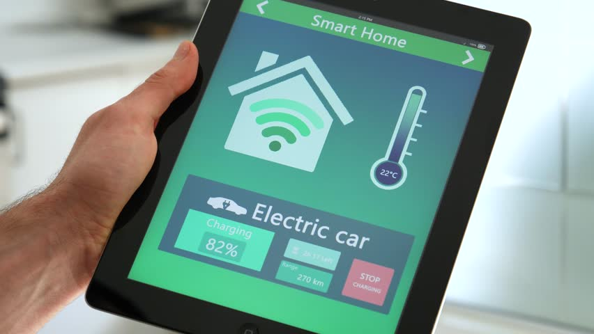 Checking the electric car status from the smart home app on a tablet. | Shutterstock HD Video #26314523