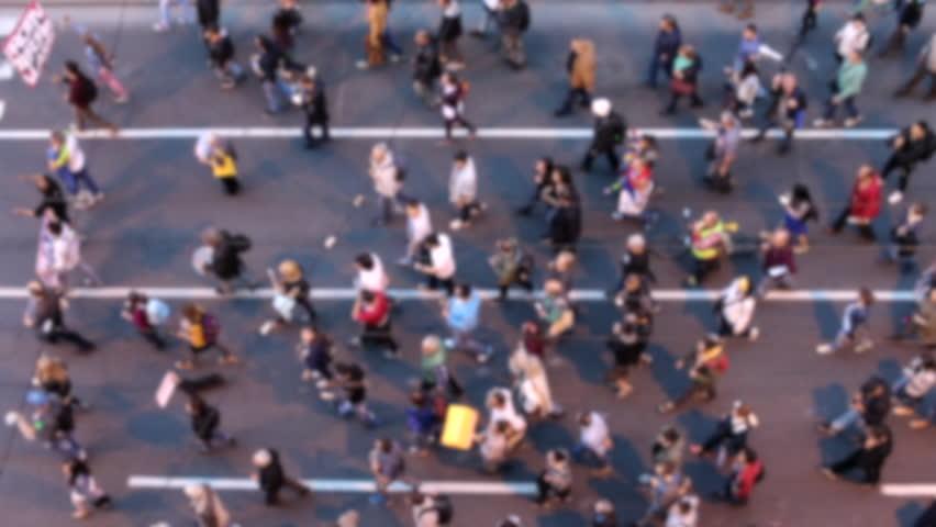 Top view of people walking. Crowd of people on street. Citylife concept. Defocused footage.