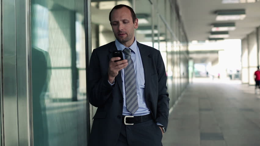Young handsome businessman with smartphone in the city  #2633132