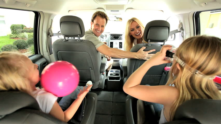 Happy Caucasian family in people carrier car ready for day beach | Shutterstock HD Video #2633585