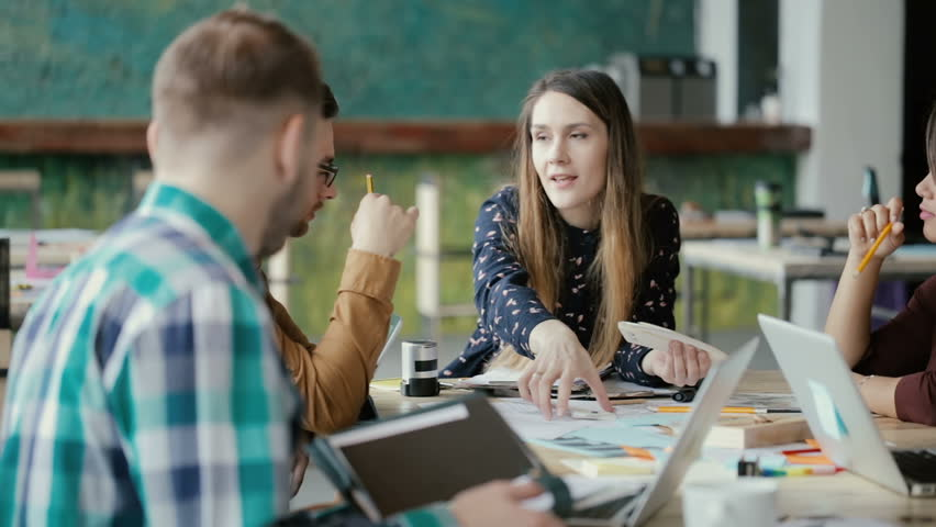 Multiethnic team meeting in modern start-up office. Group of young people discussing the new project idea. | Shutterstock HD Video #26337818