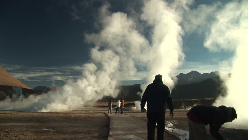 Tourists near geysers in Atacama Desert, Chile