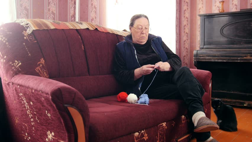 Senior Lady Sitting On The Arkivvideomateriale 100 Royaltyfritt