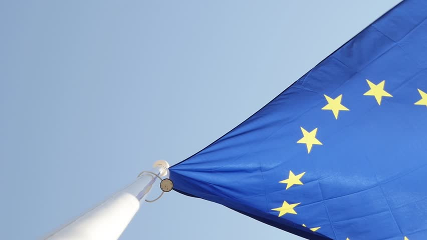 Slow motion cinematic advertising and newsworthy European Union flag flying in front of bright blue sky Royalty-Free Stock Footage #26380475