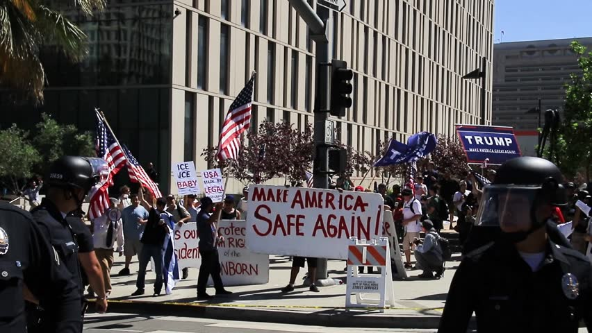 LOS ANGELES - MAY 1 2017: Mayday protesters and police face off in downtown Los Angeles during a march against President Trumps immigration policy May 1, 2017.