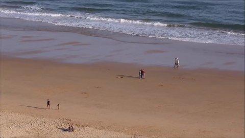 PRAIA DA ROCHA, PORTUGAL - APRIL 22, 2017: People at the famous beach of Praia da Rocha in Portimao. This beach is a part of famous tourist region of Algarve